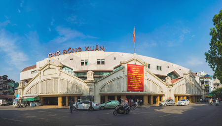 aliments: Hanoi, Vietnam - Aug 23, 2015: Exterior front view of Dong Xuan market, the largest covered market of Hanoi where the wholesale traders sell everything from clothes, household goods to foodstuffs