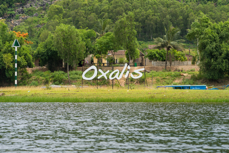 Quang Binh, Vietnam - June 16, 2016: Sign of Oxalis Adventure Tours company provide tours that explore remote jungle, wild river caves and other adventure tours in Vietnam