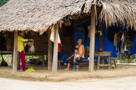 bo: Quang Binh, Vietnam - June 17, 2016: Closeup minority ethic house with people living inside the house at Ban Doong Ethnic Village, Bo Trach district