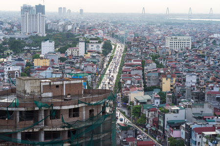 tay: Hanoi, Vietnam - June 7, 2016: Aerial view of Tay Ho district with Nghi Tam street and under construction building on foreground