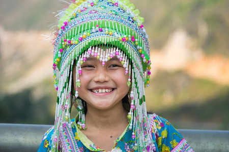 Ha Giang, Vietnam - Feb 13, 2016: Portrait of H'mong little girl wearing traditional dress during Lunar New Year holiday in Dong Van district