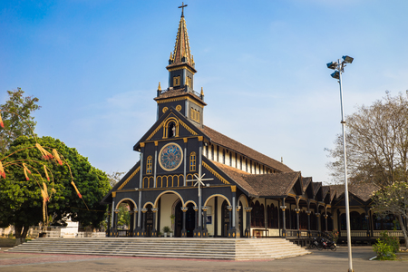 Kon Tum, Vietnam - Mar 28, 2016: Go (Wooden) Church in the city of Kon Tum in the Central Highlands of Vietnam is an ancient relic with unique wooden architecture of high aesthetic value