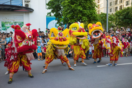 Hanoi, Vietnam - Sep 25, 2015: A show of lion dance at Times City complex in Vietnamese mid autumn festival days