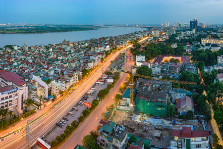 Hanoi, Vietnam - Sep 19, 2015: Aerial skyline view of Nguyen Khoai street with Vinh Tuy bridge crossing Red River on background. Hai Ba Trung district Editorial