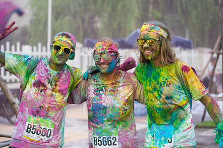 hundreds: Hanoi, Vietnam - Sep 23, 2015: Group of Caucasians taking selfie photo in public color run event in Hanoi capital city. Hundreds of people joined the joyful race named Color Me Run
