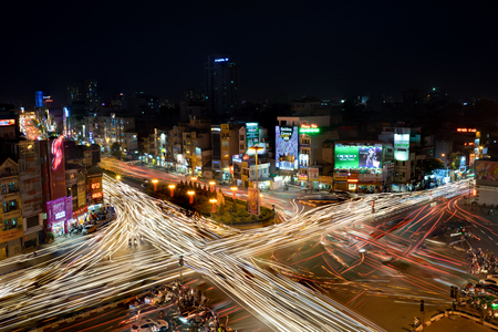 Hanoi, Vietnam - May 15, 2016: Trafic light trails at night at intersection Ton Duc Thang st - Nguyen Luong Bang st - Xa Dan st - O Cho Dua st, Dong Da district Editorial