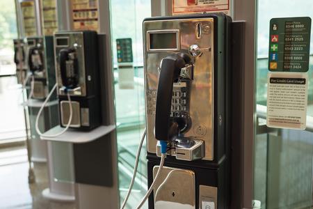 payphone: Singapore - May 2, 2016: Public telephone at Changi airport, Singapore