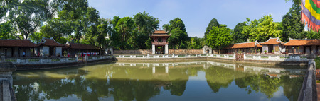 Hanoi, Vietnam - July 24, 2016: Panorama view of third courtyard in ancient Temple of Literature (Van Mieu), with the Thien Quang well and the red Khue Van pavilion, two great halls