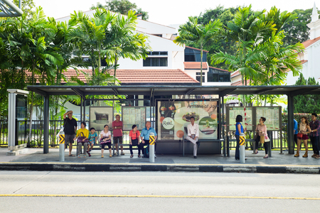 Singapore - May 1 2016: People waiting for bus at bus stop in Orchard Rd, Singapore