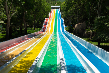 colorful plastic water-slide in swimming pool Stock Photo