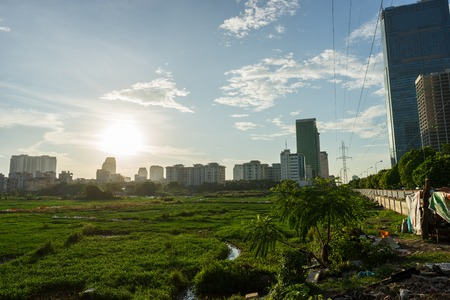 Urban wasteland with meadow in Hanoi capital city, Vietnam