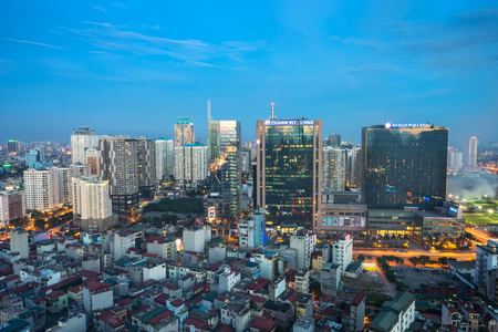 Hanoi, Vietnam - Aug 8, 2016: Aerial view of High buildings and houses in Tran Duy Hung - Pham Hung street, Cau Giay district at twilight