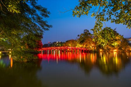 The Huc bridge (red bridge), entrance of Ngoc Son temple on Hoan Kiem lake, Hanoi, Vietnam Stock Photo
