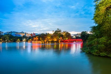 Hoan Kiem lake with The Huc bridge (red bridge) at twilight, center of Hanoi, Vietnam