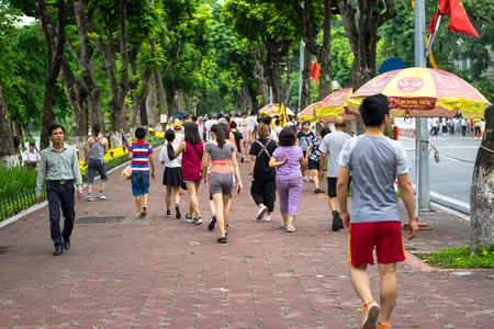 Hanoi, Vietnam - Sep 2, 2016: People walking on Dinh Tien Hoang, the walking street by Hoan Kiem lake, center of Hanoi