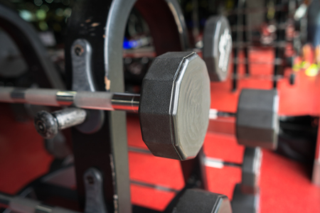 Rod and weights in the gym Stock Photo