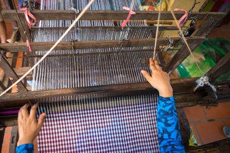 Weaving textile at Champa village, Mekong delta, Vietnam