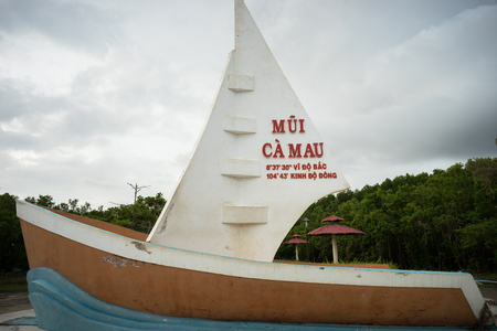 Ca Mau, Vietnam - Dec 6, 2016: Milestone Southernmost point with boat-shaped monument with sails seaward territorial claims in the region Southernmost Ca Mau, Vietnam