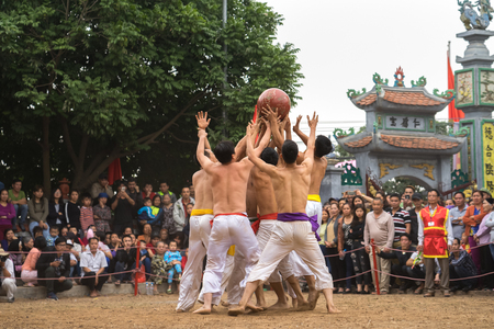 scrambling: Hanoi, Vietnam - Feb 2, 2017: : Vietnamese men playing outdoor game at the traditional ball scrambling festival in Thuy Linh village, Linh Nam ward, Hoang Mai district, Hanoi