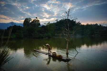 Local fisher man use fish net catch fish in lake in Hoa Binh province, Vietnam