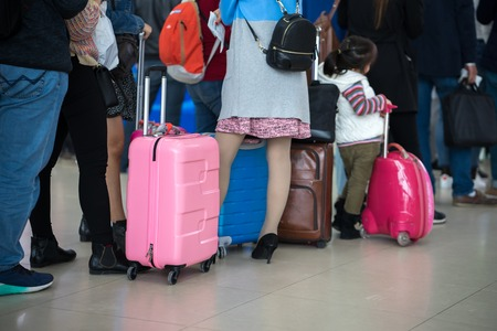 Queue of Asian people waiting at boarding gate at airport. Closeup. Stock Photo