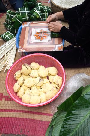 long bean: Ingredient for making Chung cake by female craftsman closeup. Traditional Vietnamese New Year (Tet) food.