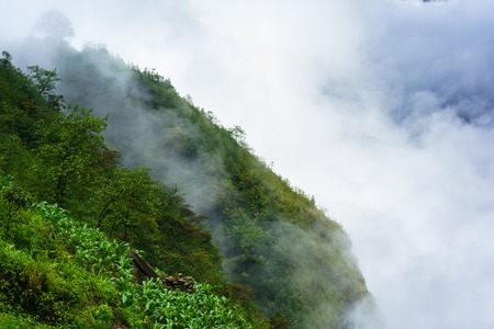 Green mountains cliff and white clouds