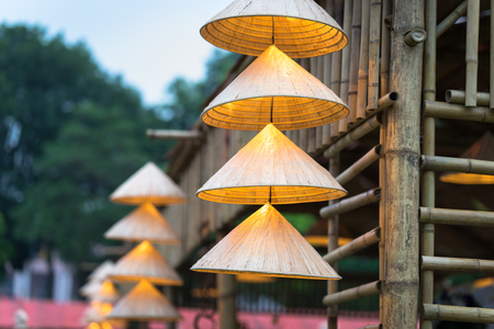 Vietnamese traditional conical hats hanging on wire for decoration. Stock Photo