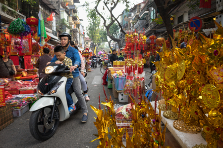 Hanoi, Vietnam - Jan 26, 2017: Hang Ma street a few days before Vietnamese lunar new year, is beautiful with a lot of decoration and flower.