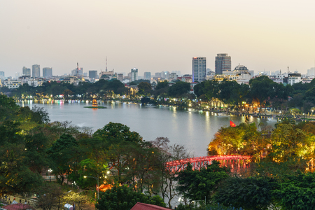 Aerial skyline view of Hoan Kiem lake or Ho Guom, Sword lake area at twilight. Hoan Kiem is center of Hanoi city. Hanoi cityscape.