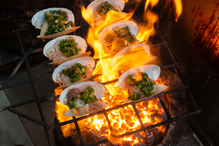 Grilled Oysters on fire with oil, green onion, roasted peanut