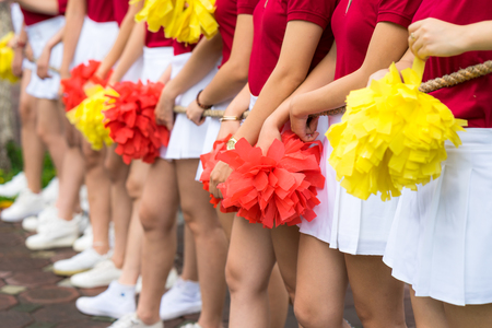 Asian young cheerleader group closeup with legs standing on row