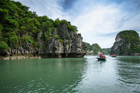 Halong bay in Vietnam with tourist rowing boats