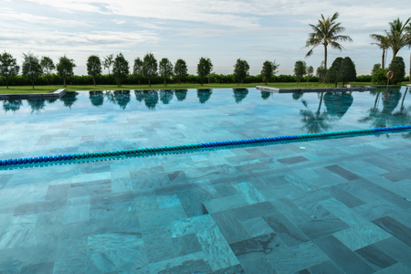 Swimming pool at tropical villa resort by the sea