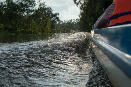 Bright splash from river water with side edge of travel speed boat