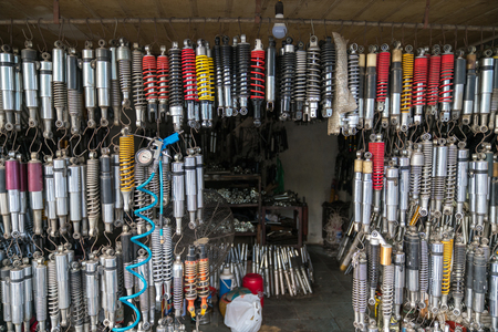 Many old shock absorbers hanging at a repair shop on Hanoi street, Vietnam