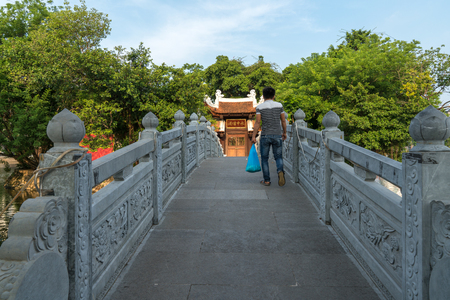 Thuy Trung Tien temple with stone bridge on Thanh Nien street in Hanoi, Vietnam Editorial