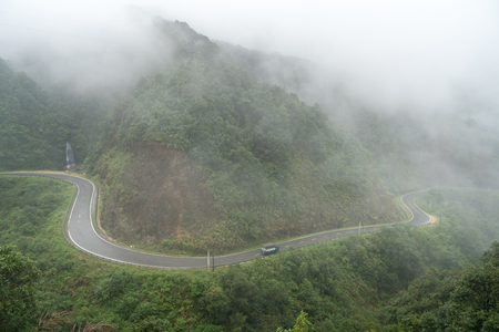 The winding road in mist in Lao Cai, northern Vietnam