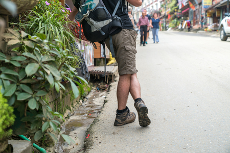 Closeup tourist with backpack in Sapa tourism town, Lao Cai, northern Vietnam