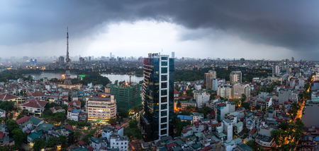 Aerial skyline view of Hanoi city, Vietnam. Hanoi cityscape by sunset period at Hai Ba Trung district viewing from Ba Trieu street Imagens