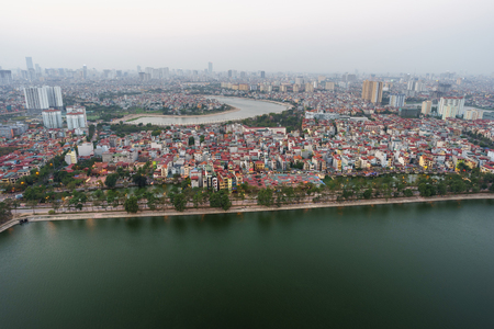 Aerial skyline view of Hanoi city, Vietnam. Hanoi cityscape by sunset period at Linh Dam lake, Hoang Mai district Imagens