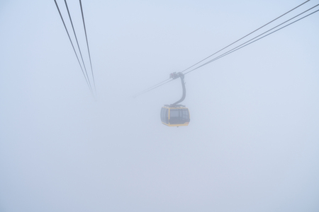 The cable car to mountain top with mist