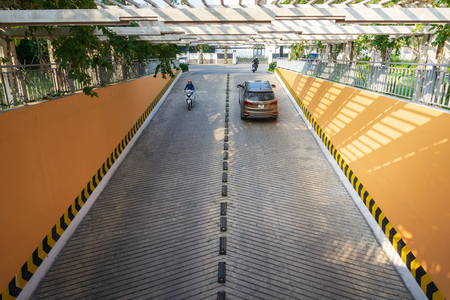 Concrete road ramp parking car garage, way up and down to car park Editorial