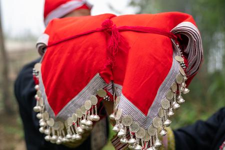 Closeup of red hat of Vietnamese ethnic minority Red Dao women in Lao Cai, Vietnam