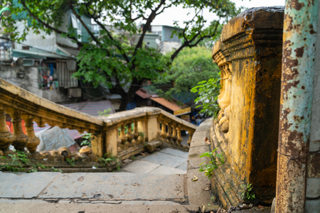 Old open outer stone staircase, steps of the old staircase with traces of weathering and destruction. Aged footpath in Hanoi city Editorial