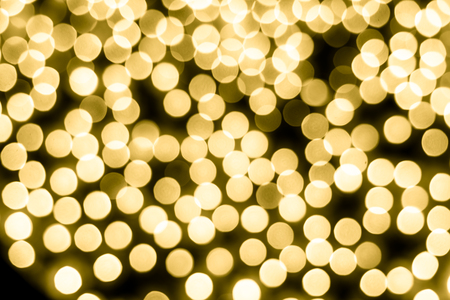 Abstract bokeh background. Soft defocused lights. Neon basic yellow color