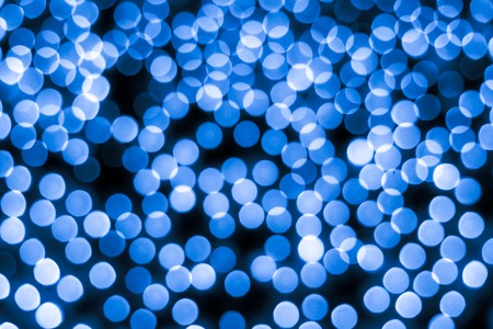 Abstract bokeh background. Soft defocused lights. Neon basic blue color 版權商用圖片