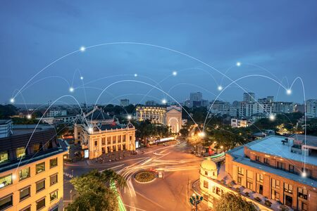 Smart city and wireless communication network concept. Digital network connection lines of Hanoi city. Hanoi opera house, old town