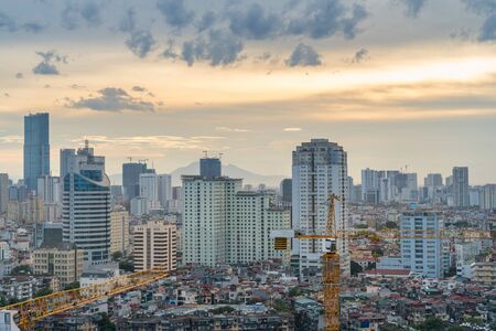 Hanoi skyline view with crane of under construction building at Thanh Cong lake, Ba Dinh district