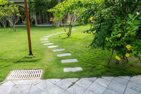 Stone paved path to the villa at tropical resort
